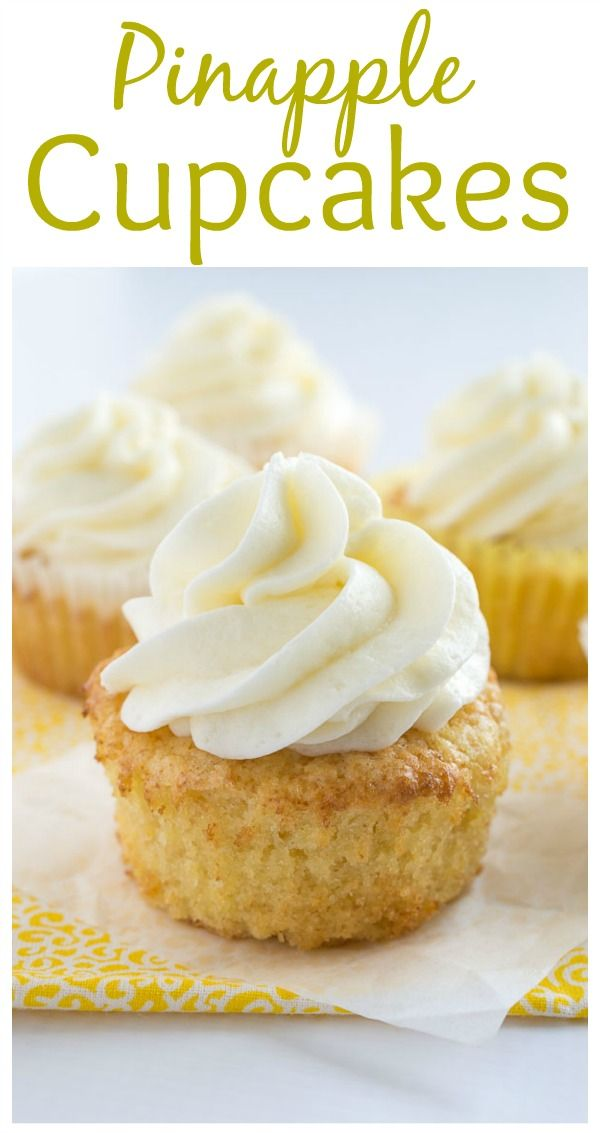 These pineapple cupcakes are moist, buttery, and loaded with crushed pineapple. They are paired perfectly with coconut buttercream for a tropical treat. | bakedbyanintrovert.com