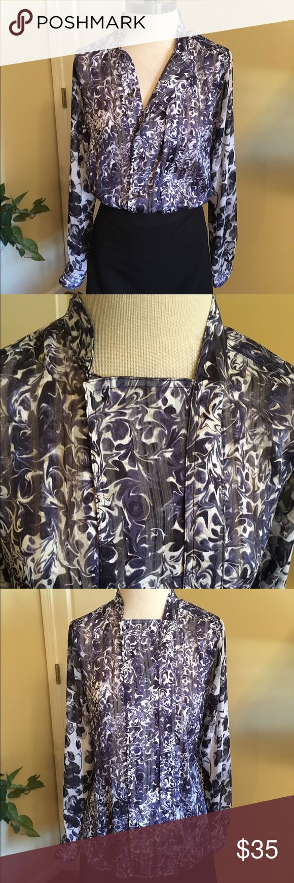 Vera Wang Floral Blouse Beautiful purple Blouse by Vera Wang. Size medium. Semi sheer but doesn't need camisole. Unique asymmetrical snap closure with pleated detail. Longs sleeves with coordinated fabric. Vera Wang Tops Blouses