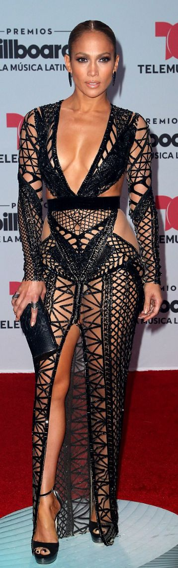 Jennifer Lopez: Dress – Julien MacdonaldPurse and shoes – Jimmy ChooEarrings – Lynn Ban