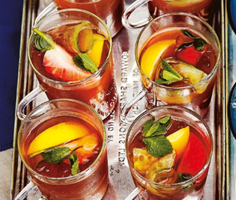 Pimm's Iced Tea ~ Serving delicious drinks at large parties is a hard task without a full bar of mixologists, right? NO! Let me introduce Mr. Punch. He is a big bowl of cocktail normally containing fruit, alcohol, and a mixer. Of course, I like to use British flavors, but you can tailor this to your taste. My biggest tips: Use lemon to preserve freshness and use homemade mixers, such as iced tea, to keep costs down. All that's left is to hold your teacup up and make a toast to all those…