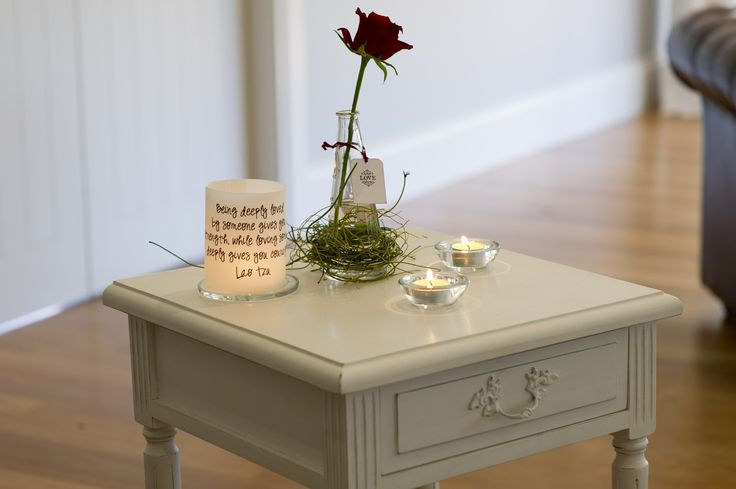 Miss Bloomfields had an amazing time creating this airy romantic candle lit room. A single red rose in a vase with dodda vine and candles on a side table in the lounge area. The bride and groom had collected their favourite quotes about love and printed them onto non flammable paper (via Etsy).  Photo by Sam at www.sdpmedia.com.au