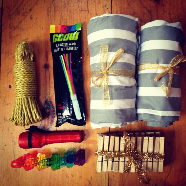Homemade fort kit: rope, clothes pins, flashlight, sheets, glow sticks