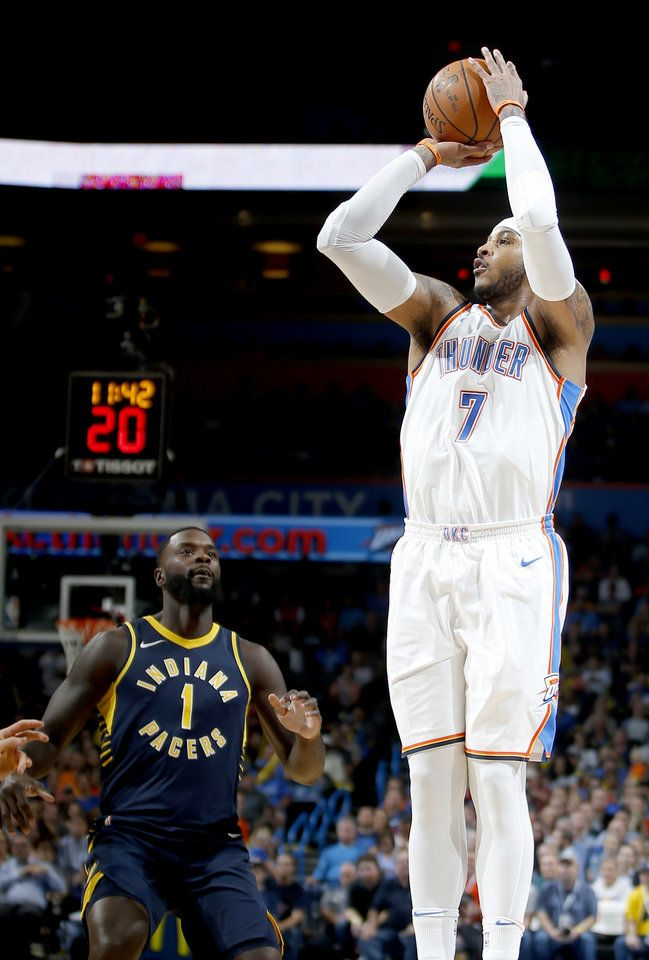 Oklahoma City's Carmelo Anthony (7) shoots  a basket as Indiana's Lance Stephenson (1) watches during an NBA basketball game between the Oklahoma City Thunder and the Indiana Pacers at Chesapeake Energy Arena in Oklahoma City, Wednesday, Oct. 25, 2017. The Thunder won 114-96. Photo by Bryan Terry, The Oklahoman