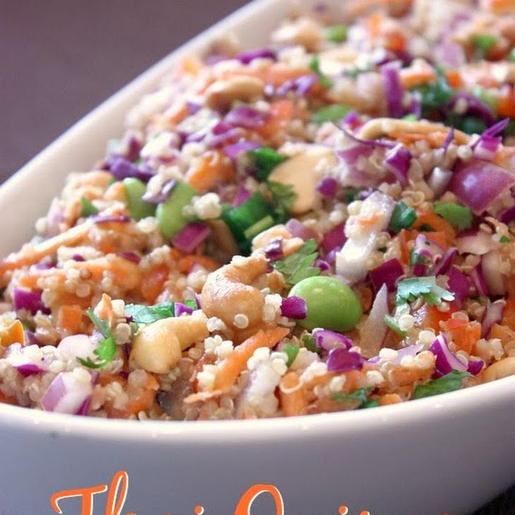 Thai Quinoa Salad Recipe Salads with quinoa, red cabbage, red bell pepper, purple onion, shredded carrots, edamame, cashew nuts, chopped cilantro, green onions, peanut butter, ginger, soy sauce, honey, red wine vinegar, sesame oil, olive oil, Sriracha, water