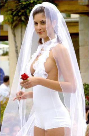 Most people go for the classy, fashionable look on their wedding day. But there's some women, who take the time to really showcase their personal style, oh, and their bodies when they get ready to walk down the aisle. Talk about leaving nothing to the imagination for the wedding night, these brides almost need to put clothes back on to wow their grooms with lingerie when they slip under the matrimonial covers.