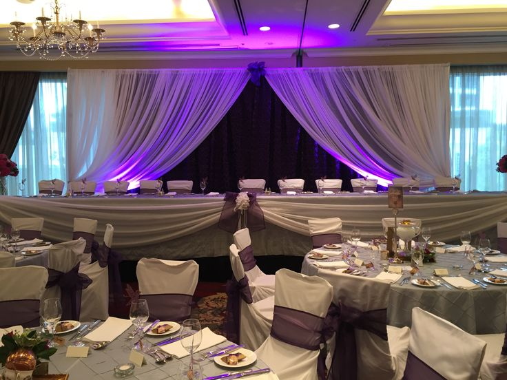 Purple and white head table with draping and uplighting from real Vancouver, BC wedding. #createweddingsandevents #vancouverweddings