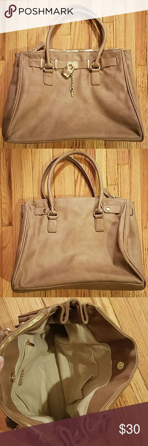 Taupe Aldo Purse Great color for fall! Medium sized bag. Gold lock and key design. Plenty of room inside with two zippered compartments on each side. One zippered pocket and two open pockets inside main compartment. Aldo Bags