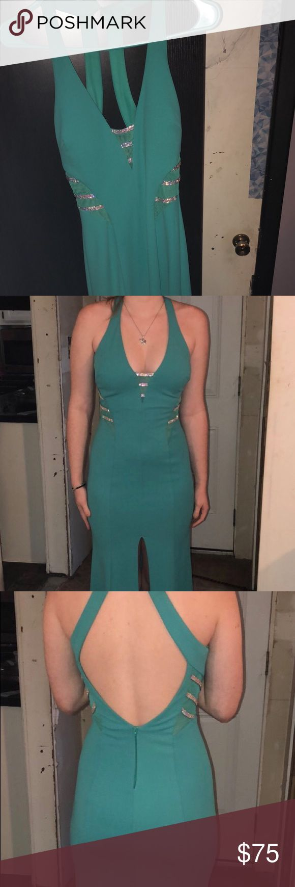 """Turquoise Prom Dress Size 1 (small). Has slit about mid-thigh; doesn't move up when you're dancing. Only see through where the simple designs are. I'm 5'6"""" and it touches the ground. With heels it barely hovers the ground. Perfect fit! Dresses Prom"""
