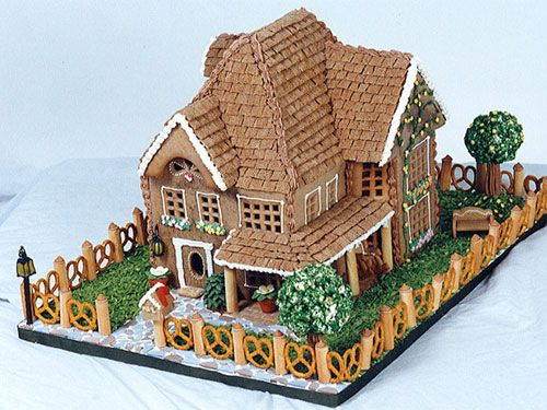 Complete with a pretzel fence, this gingerbread house looks too good to eat