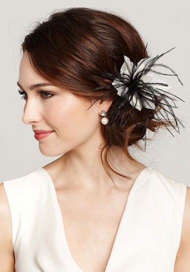 love the wispy feather details on this pretty hairpiece!