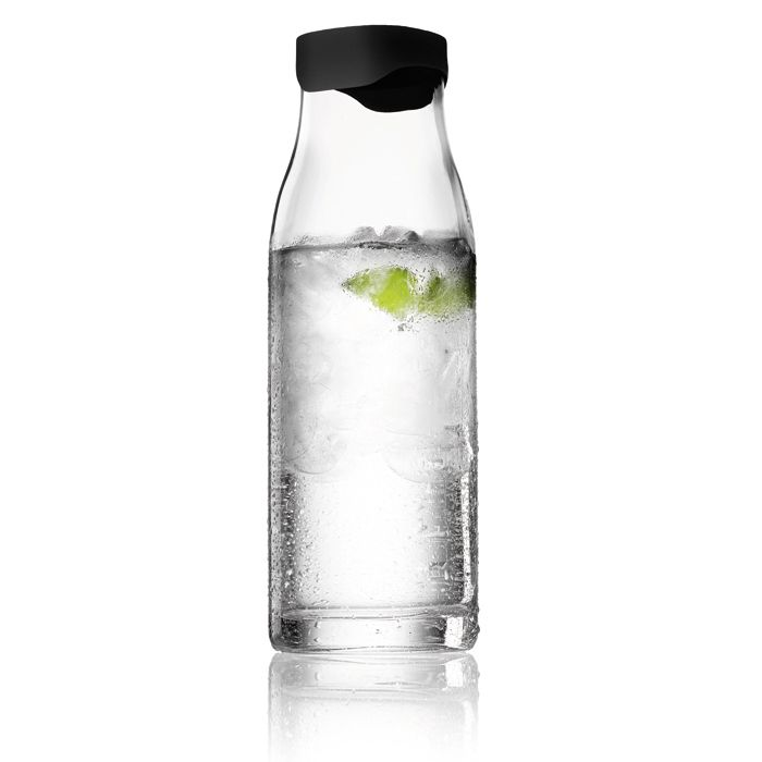 Water Carafe With Smart Lid    Tip the bottle and the steel lid cracks open just enough to let liquid flow out while holding back ice cubes and lemon wedges.