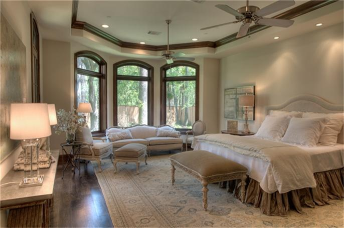 "Master Bedroom - 11' coffered ceiling, Walnut 6"" wide plank hardwood floor, stained 9"" baseboards/6"" crown. Vestibule entry with double Groin Vault faux painted ceiling with pendant lights, bay window in sitting area overlooking back garden"