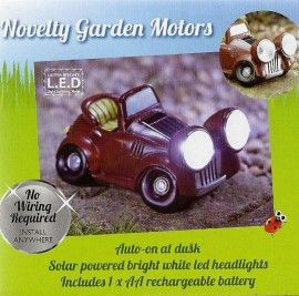 Solar powered novelty garden motors vintage car with bright white LED headlights. Auto on at dusk.