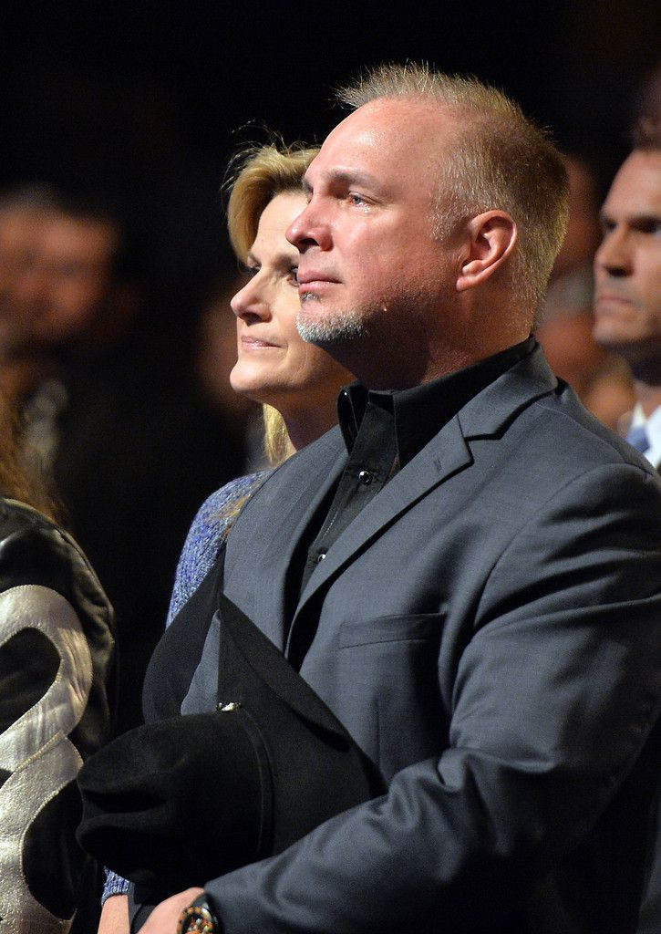 Trisha Yearwood and Garth Brooks attend the funeral service for George Jones at The Grand Ole Opry on May 2, 2013 in Nashville, Tennessee. Jones passed away on April 26, 2013 at the age of 81. - The Funeral Service for George Jones.  Hard picture to look at because show the pain he was in.