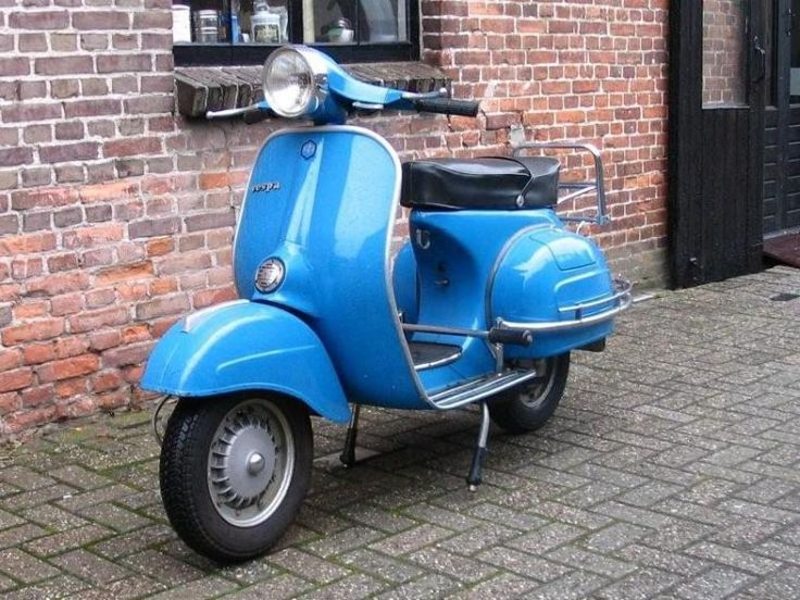 Vespa. When I get skinny, I might treat myself to one of these for around town errands. Maybe.