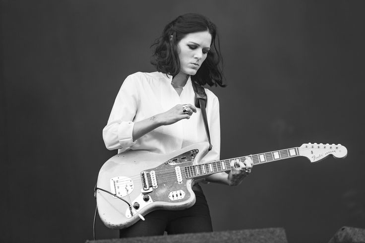 Gemma Thompson from Savages using her Heistercamp leather guitar strap! Photograph: www.emmaswann.com
