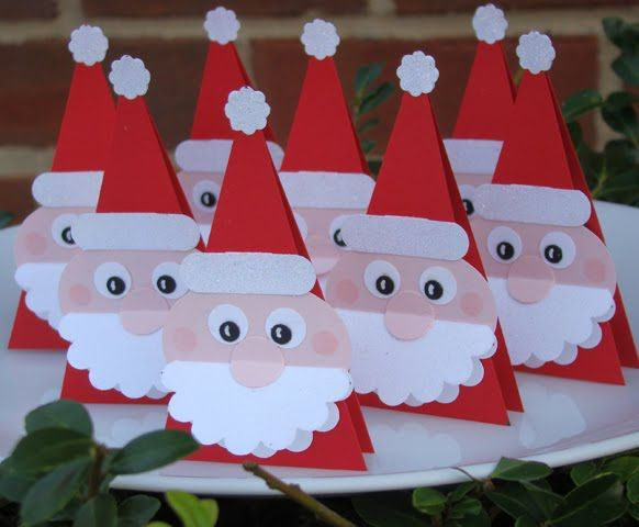 Santa Patties (They are free-standing Santas with a foil wrapped peppermint patty nested between the triangles. They would make a cute Christmas guest favor, a place card holder or if you put some ribbon on them, an adorable Santa ornament.)