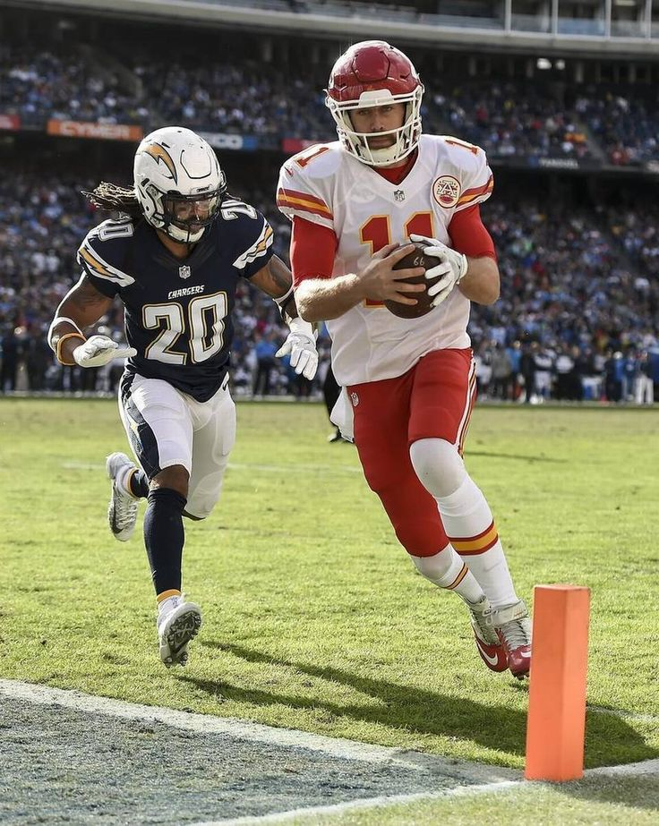 Kansas City Chiefs quarterback Alex Smith (11) ran for a 5-yard touchdown run past San Diego Chargers free safety Dwight Lowery (20) in the second quarter on January 1, 2017 at Qualcomm Stadium in San Diego.