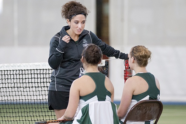 Head coach Beth Campus lends instruction to BSU's No. 1 doubles team Feb. 25, 2012.