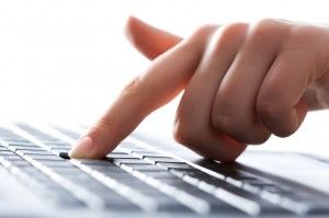 Hand and laptop