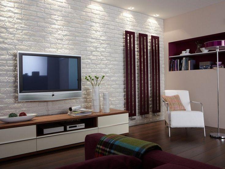 salon avec meuble TV en deux couleurs et panneau mural 3D aspect brique blanche