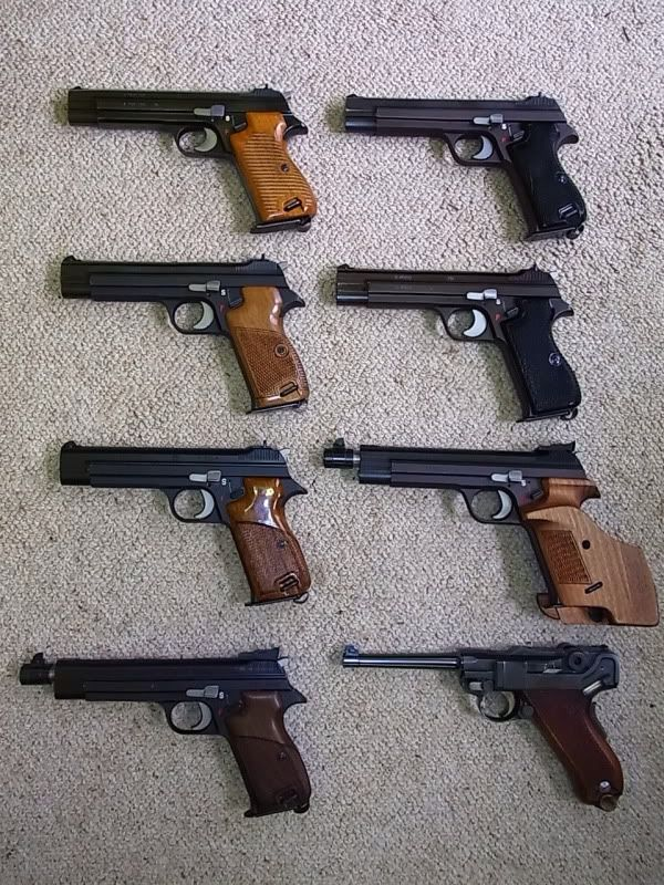 Sig Sauer Pistols >> A small SIG P210 collection.Loading that magazine is a pain! Get your Magazine speedloader today ...