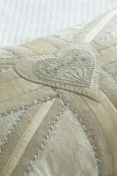 stitched heart on UK-flag / Union jack shaped cross. Cushion / Pillow.