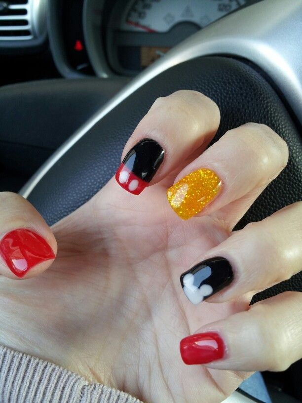 Mickey Mouse nails                                                                                                                                                                                 More
