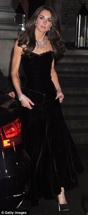 This photo reminds me of when Diana was engaged and wore a show-stopping black, strapless gown with diamonds.