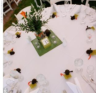 Put stump flowers, mini lanterns with tealights, table number and photo with stones surrounding? Jam jar & smore favors?