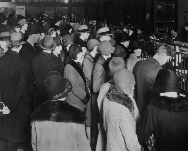 What Caused the Stock Market Crash of 1929?: Investors rush to withdraw their savings during a stock market crash, circa 1929.