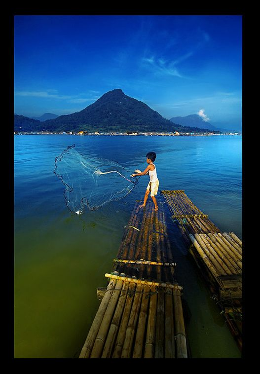 Little fisherman in Jakarta, Indonesia