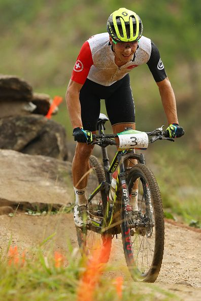 Nino Schurter of Switzerland competes during the Men's CrossCountry on Day 16 of…