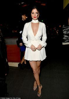 Selena Gomez shows some cleavage on the Spirit of Life Gala red carpet | Daily Mail Online