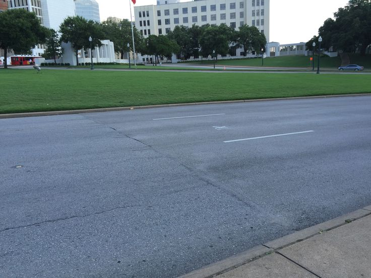 """Dealey Plaza.  """"X"""" in the street marking the spot where Kennedy was shot."""