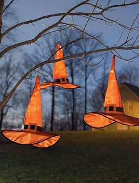 Dazzle your neighborhood this Halloween with the Set of Three Hanging Witch Hats that glow mysteriously indoors or out.