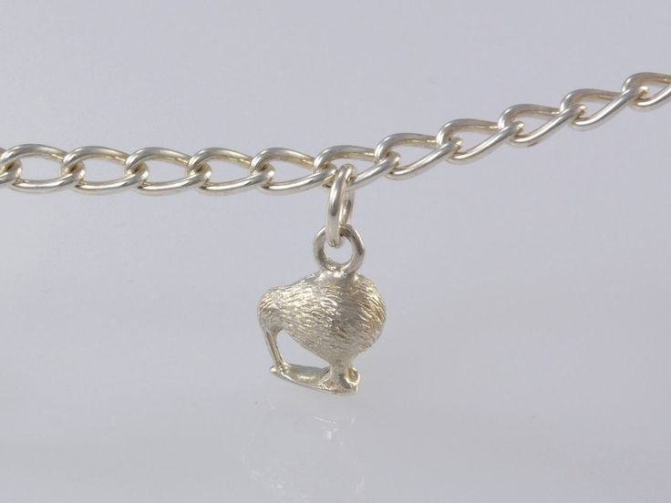 Kiwi Bird Charm. NZ$55 Silver and NZ$189 in 9ct Yellow Gold. Our little kiwi, national bird of New Zealand is flightless and cute as a button. The perfect addition to your charm bracelet or hang one on a chain as a pendant.   Jewellery made @jewelbeetle in Nelson, New Zealand.