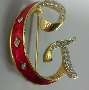 Vintage sweater initial brooch from the 50's.