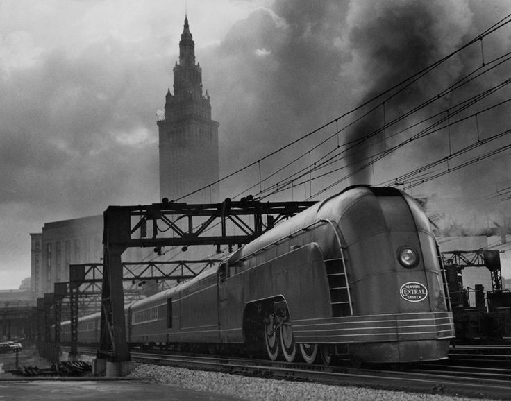 A New York Central Mercury train is dwarfed by Cleveland's Union Station, November 1936.Photograph by J. Baylor Roberts, National Geog...