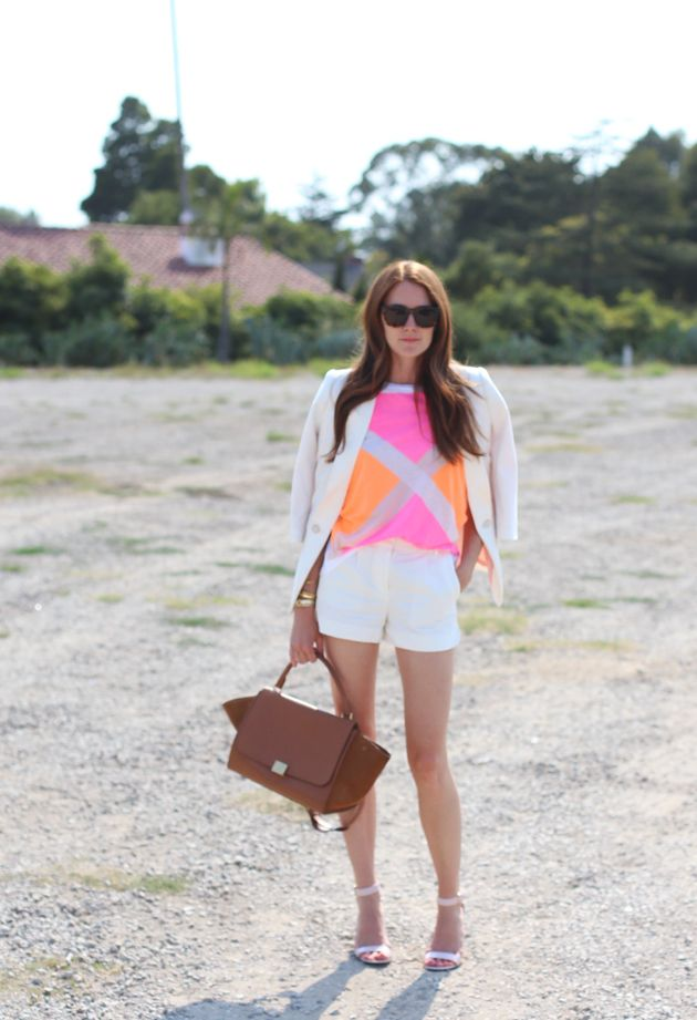 neon colored top and white suit