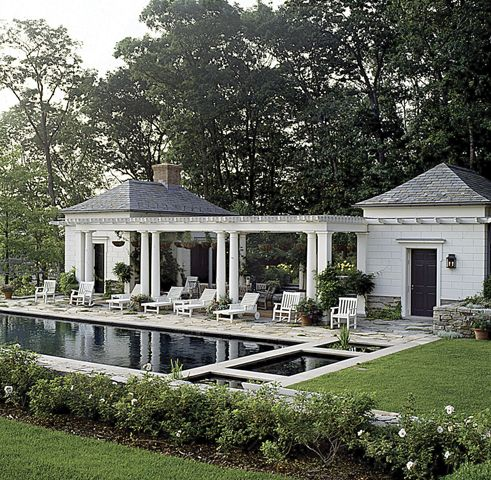 Bridgewater, Connecticut - White pillars and wood. Elegant with the pool and two side buildings.