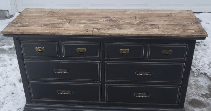 Beautiful dresser, painted black and lightly distressed. Stained wood planked top. The dresser is made by Basset.   I usually don't pain...