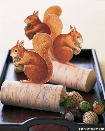 Paper Squirrels  Guests will go nuts over these cute critters. Squirrels perched atop logs filled with foil-wrapped chocolate chestnuts, hazelnuts, and walnuts make sweet seasonal tokens. Put one at each setting at the Thanksgiving table. You can write guests' names on the logs before assembling them so the favors can double as place cards