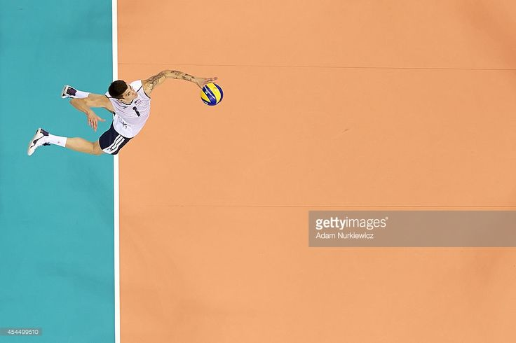 Matthew Anderson of USA serves the ball during the FIVB World Championships match between USA and Iran at Cracow Arena on September 2, 2014 in Cracow, Poland.