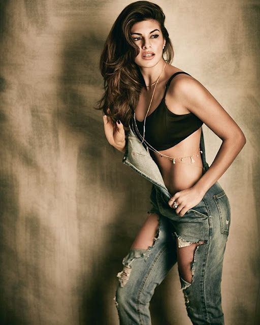 Jacqueline Fernandez skimpy , sexy , alluring shredded jeans overall . - Bollywood Reporter