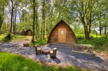 Wooden wigwams at Loch Tay Highland Lodges