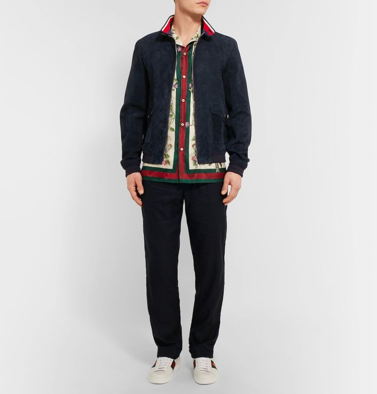In its own discreet way, the Harrington jacket is timelessly cool, and that has a lot to do with Messrs Steve McQueen and James Dean who popularised the style in the '50s. <a href='http://www.mrporter.com/mens/Designers/Gucci'>Gucci</a>'s luxurious version is crafted from butter-soft suede in a versatile navy hue. Made in Italy, it has buttoned throat latch, spacious flap pockets at the front and insulating ribbed-knit trims. Wear...