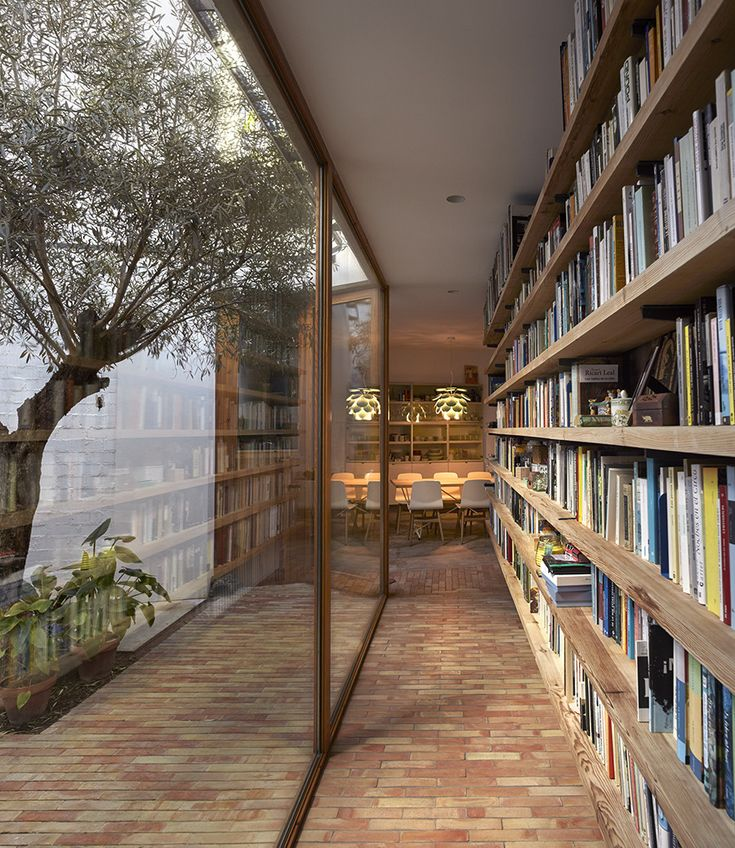 love the bookcase, especially across from a wall of glass