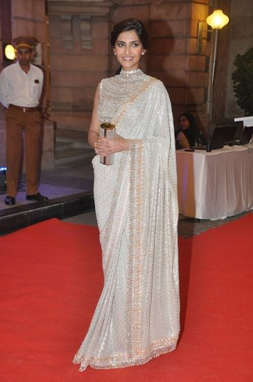 Sonam Kapoor in Abu Jani and Sandeep Khosla's collection of sarees. To view…