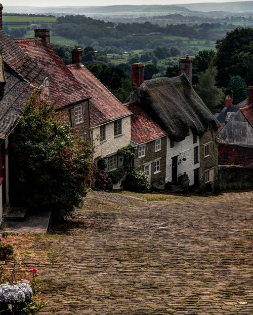 Close your eyes and dream of England -    The village of Shaftesbury, Dorset, with a row of old cottage on the country road.